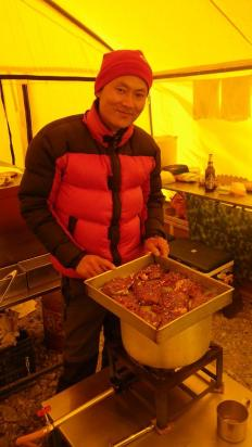 da pasang our headcook with a tray load of marinated yak steak