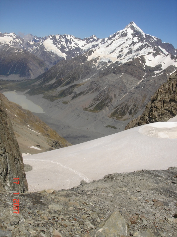 On top of Ball Pass, looking down to the Hooker Lake, the prominent mountain is Mount Sefton.