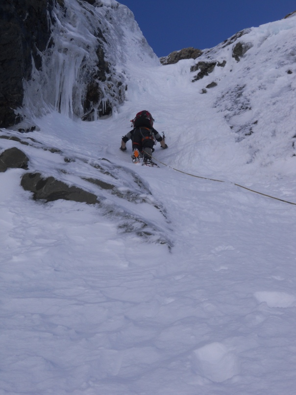 Me leading up the couloir, beautiful ice climbing conditions. (Photo: Alan Silva)