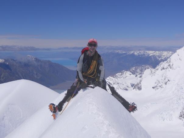 Me enjoying straddling the summit of Mt Dixon. (Photo: Alan Silva)