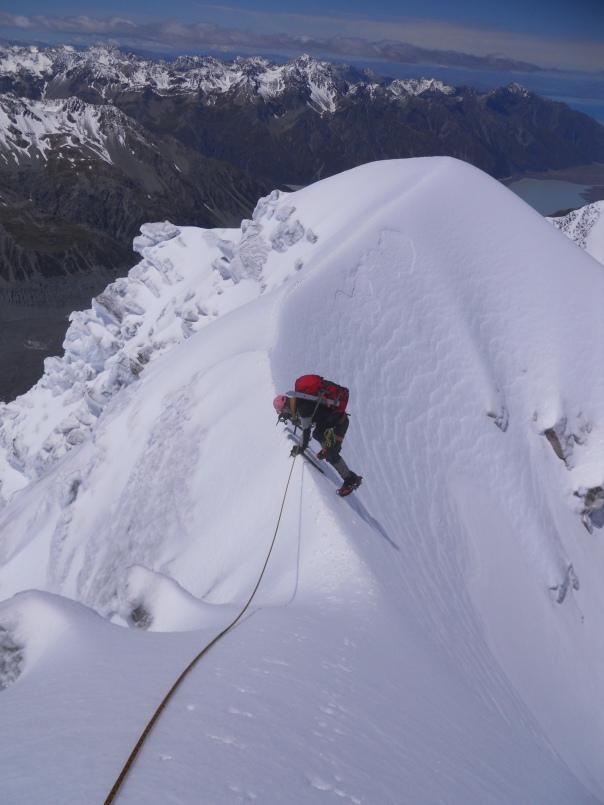 Me down climbing the summit ridge. Not a place to slip. (Photo: Alan Silva)