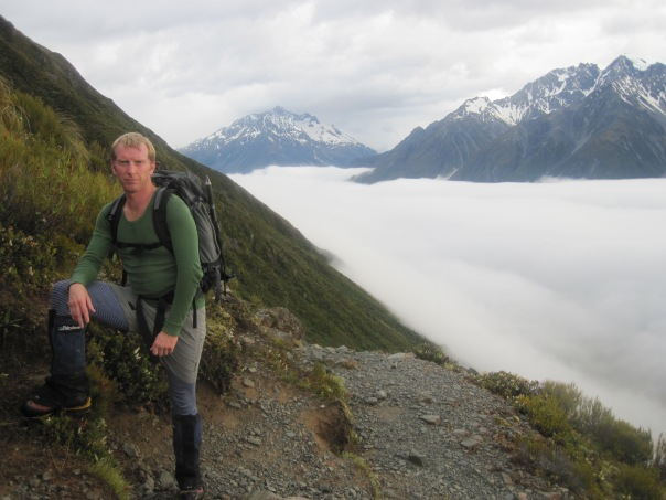 David Ellacott on the way up Mt Wakefield.  The Tasman valley below him hidden under early morning cloud.