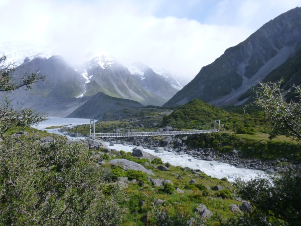 Walking up the beautiful Hooker Valley track, with one of the large new swing bridges visible in photo centre.