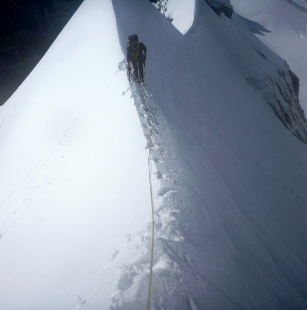 Alan Silva negotiates the east ridge of Mt Dixon with lots of snow and a lovely icy knife edge