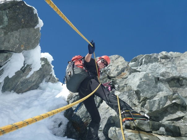 Alan Silva on belay whilst down climbing the soth face of the east ridge