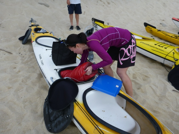 Stephanie packs our kayak in the morning.