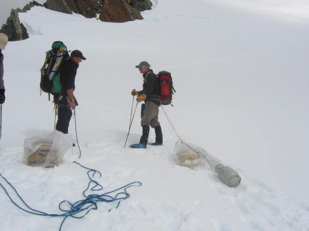 Hauling our food from the chopper landing site on the Tasman glacier up to the Kelman hut in plastic bags.