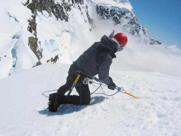 Setting up a belay using a T-slot in the snow on Mt Alymer