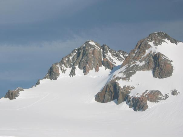 View of 9144 - the prominent peak in the centre.  The couloir route is the natural snow gully to the right of the summit and the red buttress rock climb is just to the left of the prominent central buttress leading down from summit.