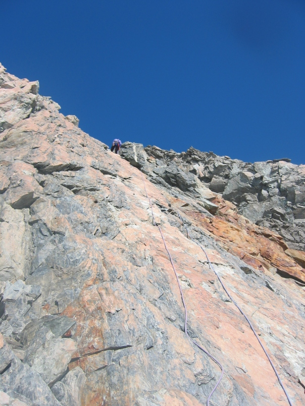 Rapelling off the 'Red Buttress' rock route on 9144