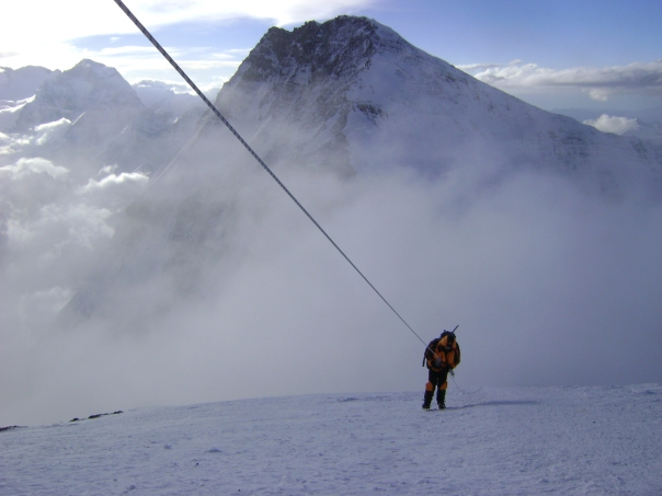 An exhausted Jim Morrow escaping the death zone in 2011 with frost bitten fingers after a failed summit attempt