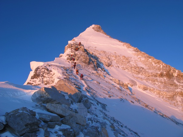 Sun rising over the 3rd step and the summit pyramid of Everest North East Ridge