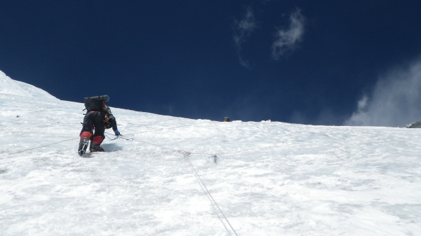 Climbing fixed ropes on the North Col at 6500m