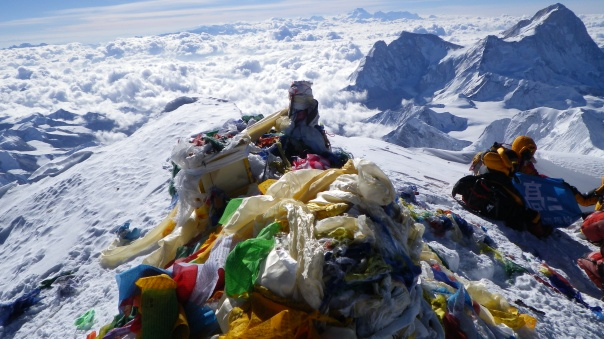 View from the summit - prayer flags are the colored scarves