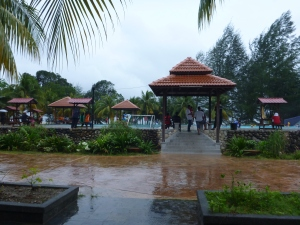 The view from the Pelangi Balau dining area of the rain pouring down over the swimming pool