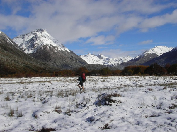 The start of the trek follows a valley through peat fields covered by snow.