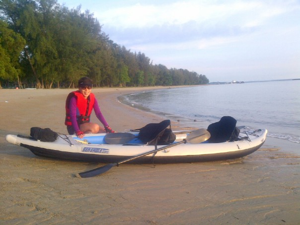 "Stephanie prepares the ""Divorce Machine' on a beautiful morning on Changi beach."