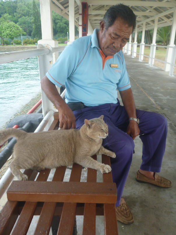 The Malay caretaker 'Supar' who has worked in the island since 1954 with one of his 30 lovely cats.
