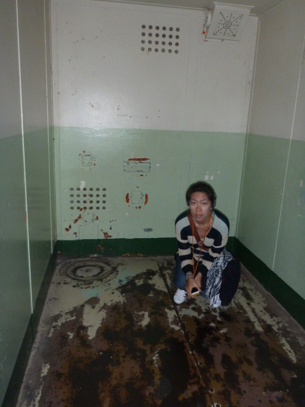Stephanie loving being in a solitary confinement cell on Alcatraz.