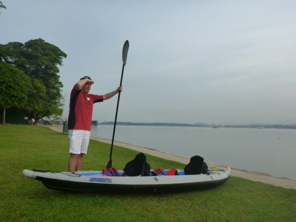 Cabin boy Blair Spendelow with the Div orce Machine checking the conditions frrom Sembawang beach.