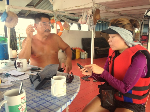 Mr Ang explains to Stephanie the technicalities of fish farming