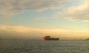 Paddling across the Johor Strait.