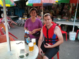Bevan enjoying a beer on Pulau Ubin with the friendly store owner