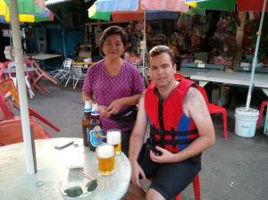 Bevan enjoying a beer on Pulau Ubin with the friendly store owner