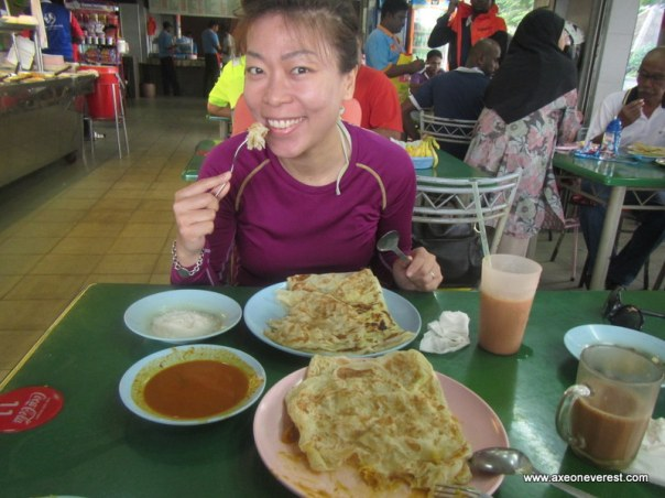 Stephanie fueling up on Roti Canai in Gelang Patah before we start.  This stuff is heavy and no need to eat for a few hours afterwards, perfect for kayaking!