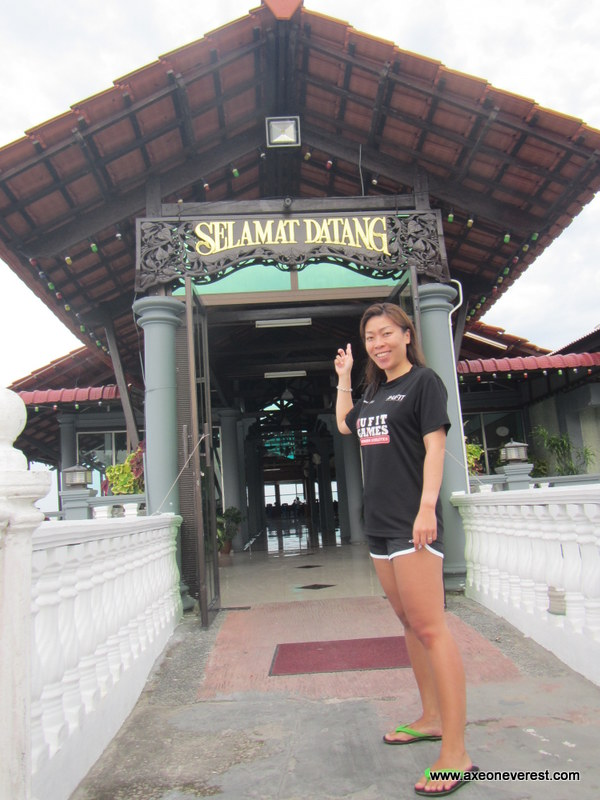 Stephanie outside the front entrance - 'Selamat Datang' means 'Welcome' in Malay.