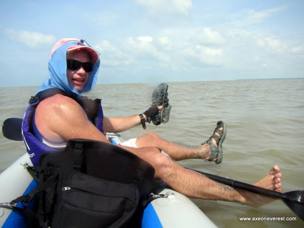 Paddling up the west coast of Malaysia towards Kukup fishing village.  The water was so shallow even though we 200m offshore.  I decided to jump out and sunk up to my knee's in very soft mud.