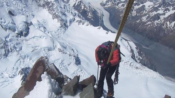 Alan Silva abseiling down the summit rocks of mt Cook.