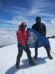 Axe and Robert Mills on the summit of Tahurangu with the NZ fire service flag. The expedition donated NZ$1000 to the Toko and Stratford volunteer fire brigades on the summit.