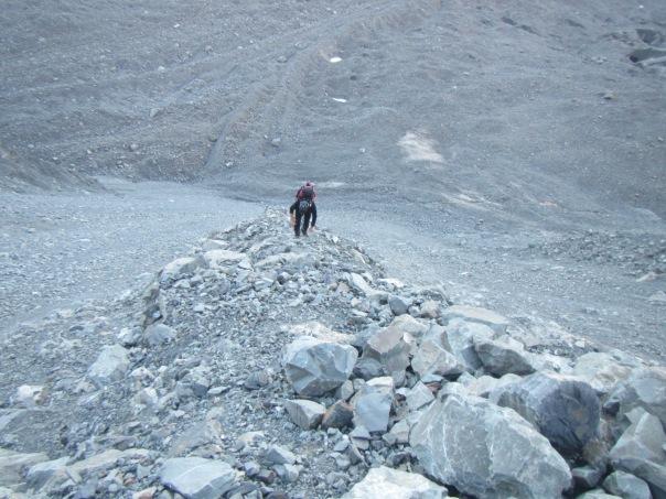 Alan Silva working his way up the steep loose scree slopes towards Cinerama Col.