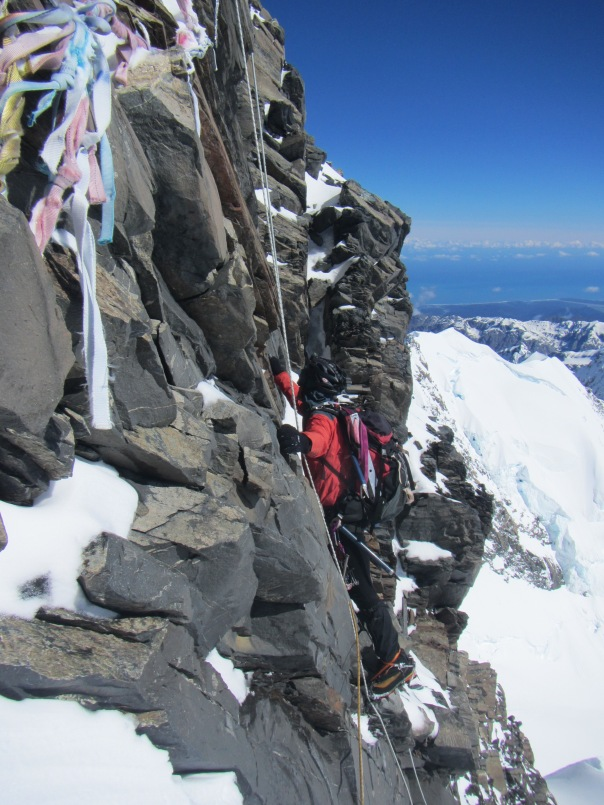 Alan Silva in his element climbing the summit rocks on Mt Cook.