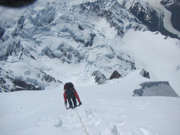 Alan Silva carefully down climbing from the summit of Mt Cook.