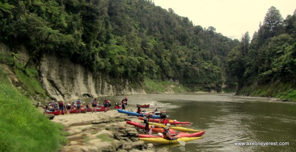 Kayakers on the banks of the Whanganui river.
