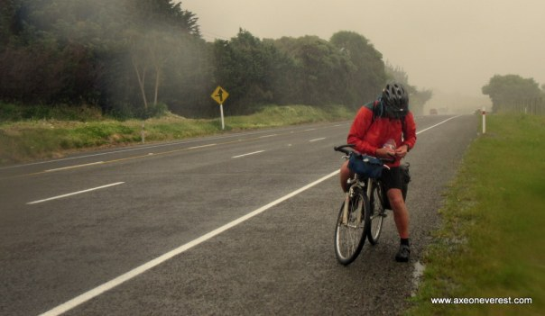 Alan Silva getting wet during a rain storm on the cycle south.