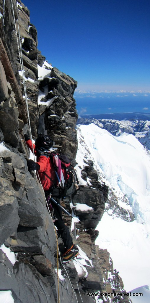 Alan Silva climbs the summit rocks on Aoraki Mt Cook.