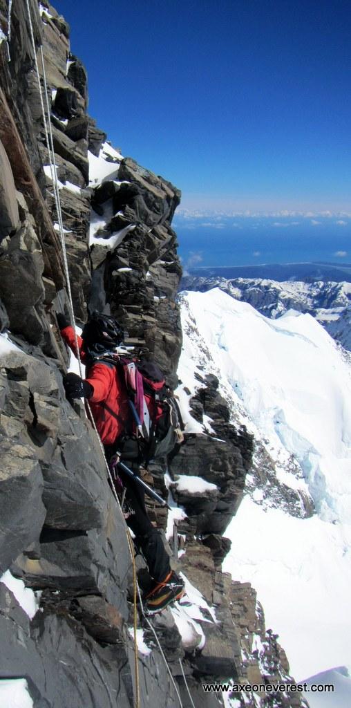 Alan Silva climbs the summit rocks on Aoraki Mt Cook.