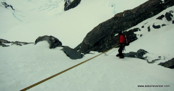 Alan Silva descending the summit rocks on Aoraki/ Mt Cook.