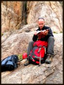 Checking out the guide book before we start climbing