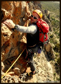 Rounding the final traverse with 140m of air under my feet on 'Syrinx'