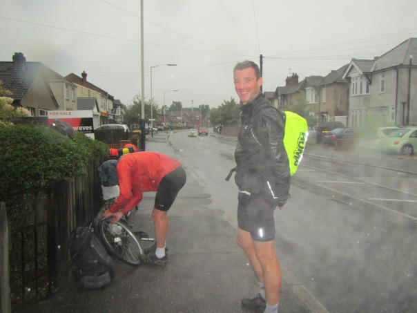 Barclay getting cold as Alan fixes his puncture in the outskirts of London