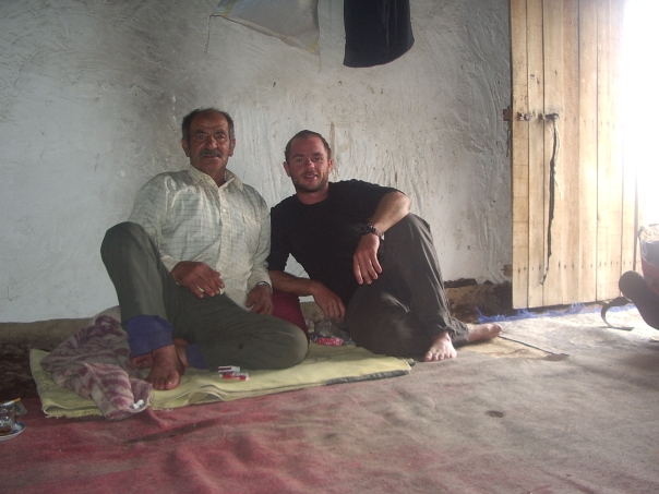 With my new friend, an Iranian Shepherd is his  simple but comfortable hut on the side of Mt Damavand.
