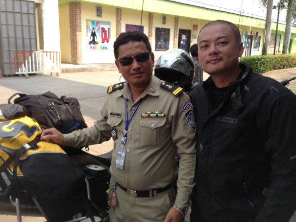 Dealing with corrupted border/custom officers in Poipet, Cambodia. Part of the experience. (Apr 2014)