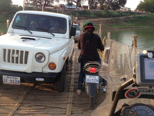 Riding along a bamboo bridge in central Cambodia. It's only good for 6 months.  (The monsoon will wash it away, only for the villagers to rebuild after that. Talk about resilience.)