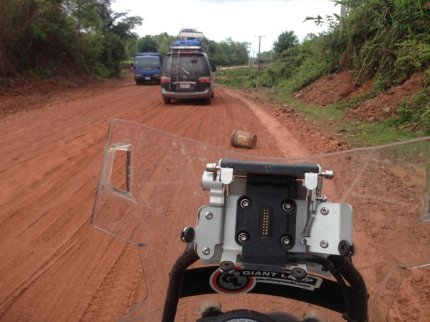 On the national highway in Laos, built by the same people who worked on the Cambodian national highway.