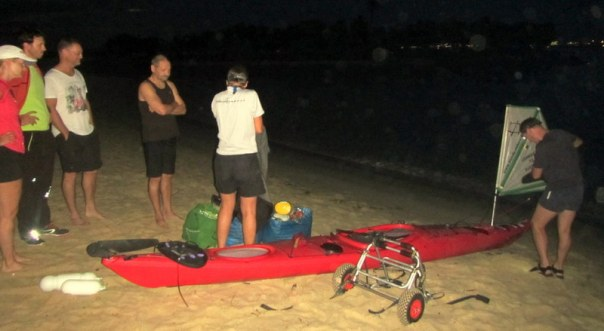 Sandy Robson prepares her kayak on Tanjung Beach in Singapore ready for departure to Batam Indonesia (Sunday 26 April 2015)