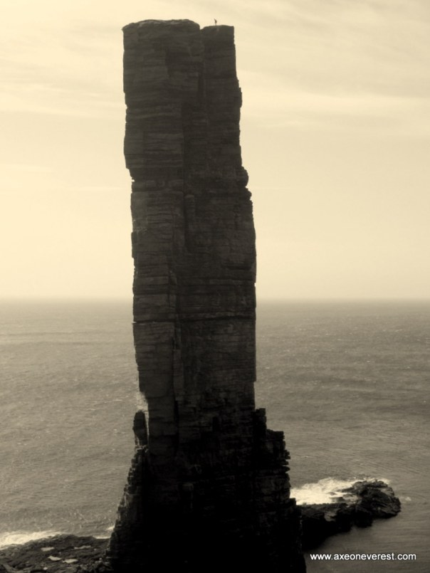 A lone German climber stands on the summit of the Old Man of Hoy